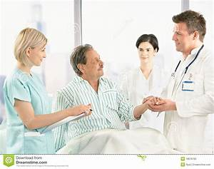 Doctors Talking To Old Patient In Hospital Stock Photo ...