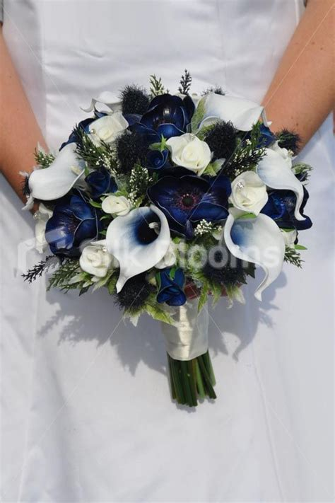fresh touch dark blue anemone bridal bouquet  roses