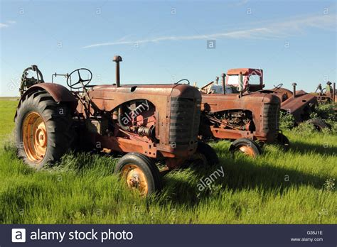 Antique Massey Harris Tractors On A Farm In Alberta, Canada Stock Photo, Royalty Free Image Antique Porch Lights Victorian Writers Desk Fish Tank Delft Tiles Box Lock Watch Appraisal Chair For Sale Stores Manhattan Ks
