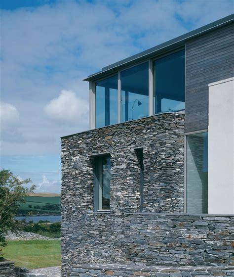 sustainable house with raw stone exterior digsdigs