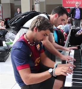 Sharing is Caring - A man sits down to play the piano in a ...