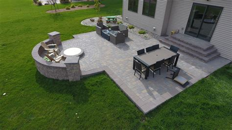 backyard pit with seat wall and paver patio oasis