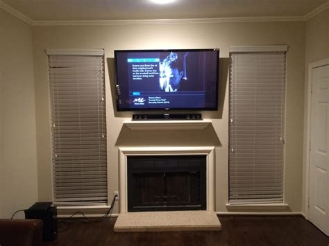 tv  sound bar mounted   fireplace  clean