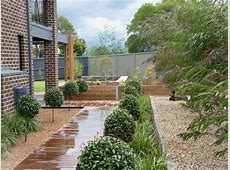 Australian native garden design using pebbles with deck