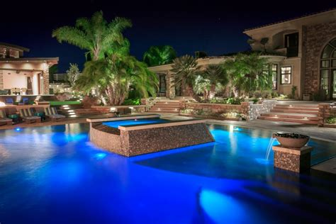 tropical pool oasis  water features  fire pit