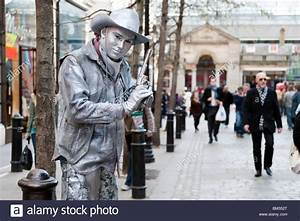 Silver painted human statue of a cowboy in Covent Garden ...