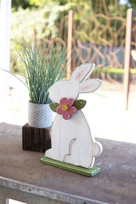 painted wooden rabbit  red flower