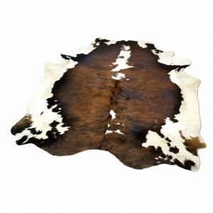 Tapis en peau de vache la vache normande achat vente for Tapis peau de vache avec canapé maison