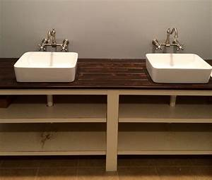 a bathroom vanity made out of a stained cedar plank With custom bathroom countertops with sink
