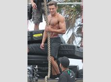 Zac Efron looks RIPPED as he goes shirtless to complete