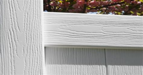 nice colonial white vinyl fence wood grain certagrain
