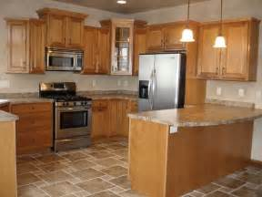 oak cabinet kitchen ideas kitchen design with oak cabinets and stainless steel appliances this kitchen boosts tile