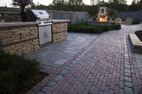 Unilock Bricks by Unilock Fireplace Outdoor Kitchen Patio Walkway Wall