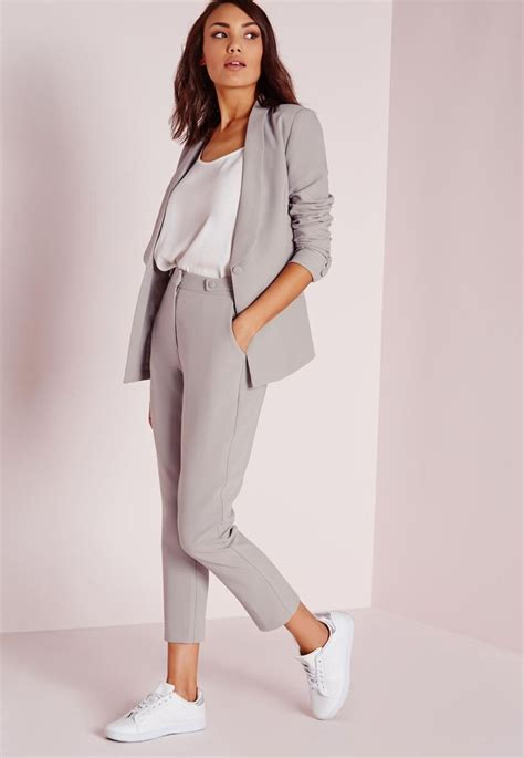 Trendy Sneakers 2017/ 2018  Grey trouser suit white loose silk top and white minimalist ...