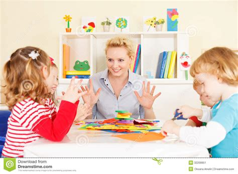 talking with children stock image image of 995 | teacher talking children preschool young smiling discussing group learning having fun selective focus to 32209951
