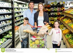Cute Family Doing Grocery Shopping Together Stock Photo ...