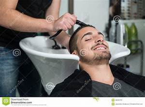 Portrait Of Male Client Getting His Hair Washed At Salon ...