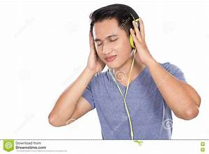 Asian Young Man With Headphones Listening To Music Stock ...