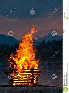 Hot Camp Fire Of Wood Burning Near Water Stock Photos ...