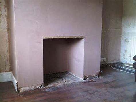 plaster stone clad fireplace plastering job