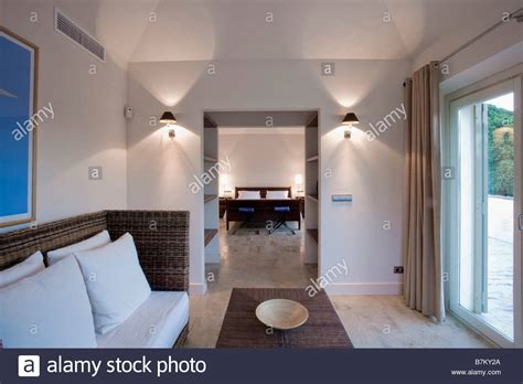 lighted wall lights either side of doorway of living room in 21951282 alamy