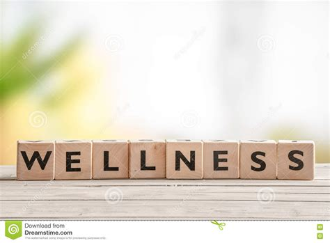 The Wellness by Wooden Sign With The Word Wellness Stock Photo Image Of