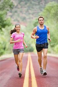 Running people - two smiling runners jogging stock photo ...
