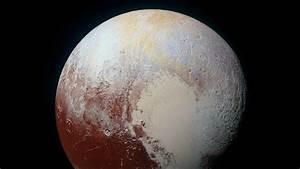 A color-enhanced photo of Pluto, taken by NASA's New ...