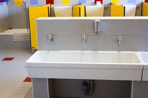 Bathrooms Of A School For Children With Low Ceramic Sinks