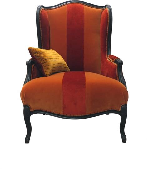 velvet wingback chair and orange traditional