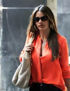 Sofia Vergara's Billowy Shirt Keeps Blowing Open To Reveal