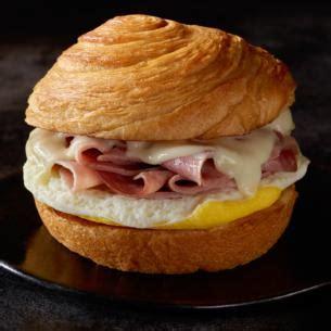 slow roasted ham swiss egg breakfast sandwich