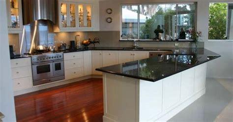 black granite benchtops  white shaker cabinets pretty