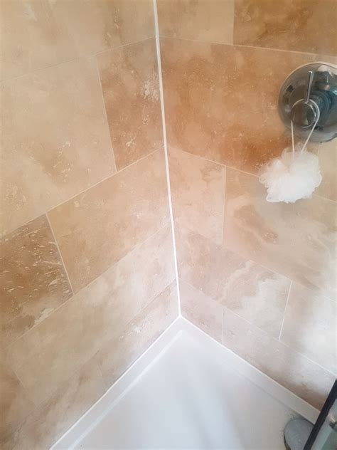 refreshing a travertine tiled shower cubicle