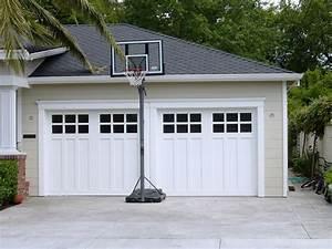 Custom wood carriage house garage doors beautiful solid for Carriage type garage doors
