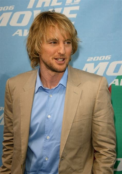 owen wilson sporting  long layered haircut styled  conceal  receding hairline