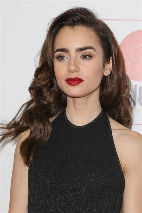 lily collins wavy barrel curls side part hairstyle