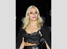 Pixie Lott flashes her taut tummy as she parties with