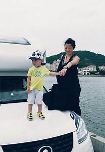 Fang Ling With Her Son And Their Recreational Vehicle Fang