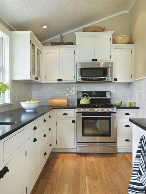 white cabinets black countertop home design ideas