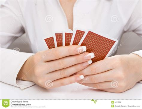 Woman's Hands Holding Playing Cards Stock Image