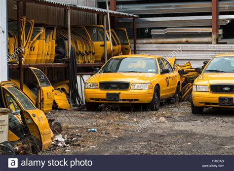 yellow cab garage in yellow taxi cab junk yard repair garage with spare doors stacked stock photo royalty free