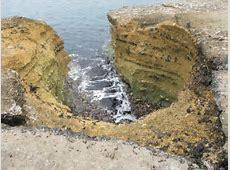 A geo in rocks between Ballintoy Harbour © Eric Jones