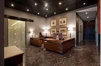 good looking office lobby interior design dark marble flooring, dark ceiling, recessed lighting ...
