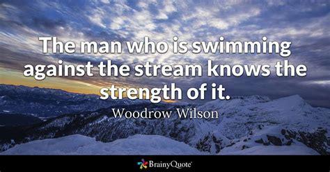 man   swimming   stream
