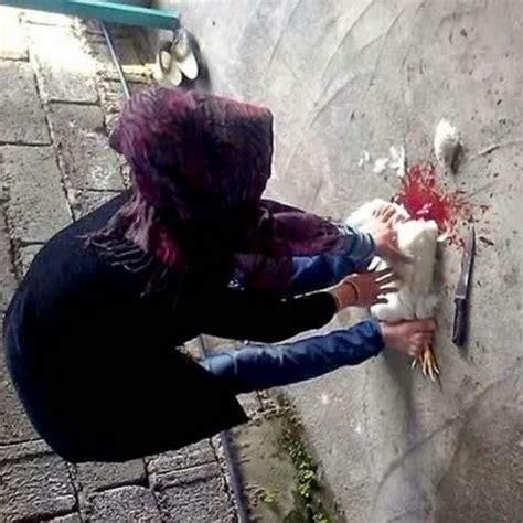 Women Slaughter Chicken