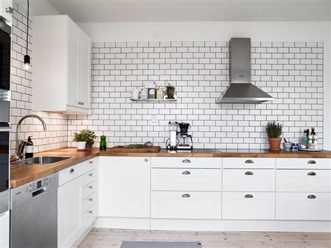 white kitchen with white subway tile a white tiles black grout of kitchen coco lapine 2107