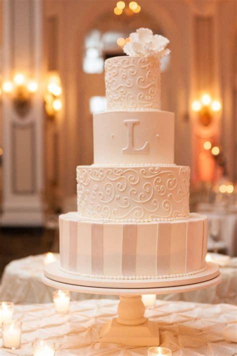 elegant vintage buttercream wedding cakes roses rings