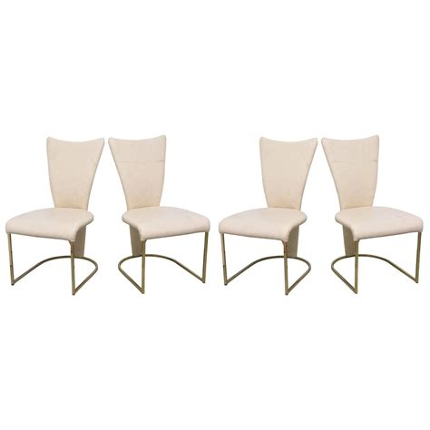 design institute  america post mod brass dining chairs