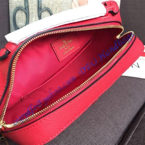 louis vuitton monogram empreinte leather saintonge scarlet